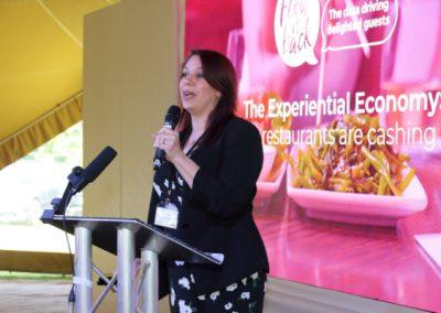 Julie Platia of Feed It Back presenting at Metro Forum 2019